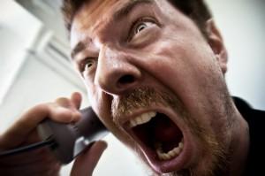 Man shouting at telephone
