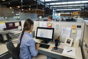 Woman Seated at Desk Using OptiPlex 3030 AIO Touch Desktop