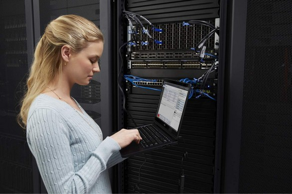Woman in Data Center with Latitude 14 7000 Series Touch Notebook