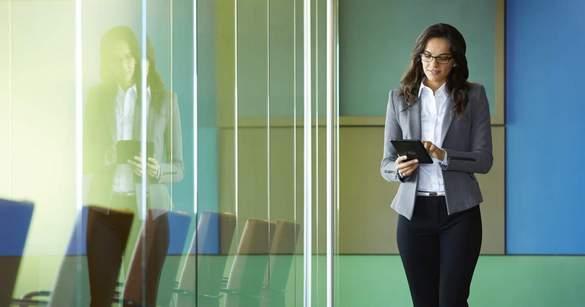 Businesswoman in Hallway Using Venue 8 Pro Tablet