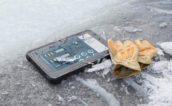 A Dell Latitude 12 Rugged Tablet (Model 7202) computer resting on a frozen stream with shards of ice surrounding it and a pair of orange gloves partially resting on the tablet.