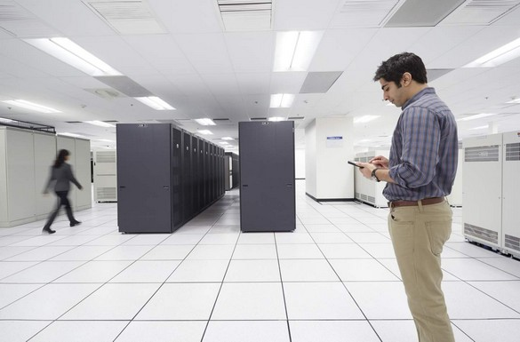 Man in a Large Data Center, Using Venue Tablet