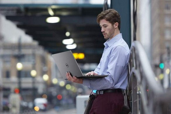 Man on Sidewalk with Vostro 14 5000 Series Notebook