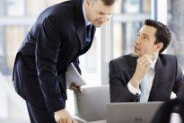 Men Talking at Desk with Latitude 14 7000 Series