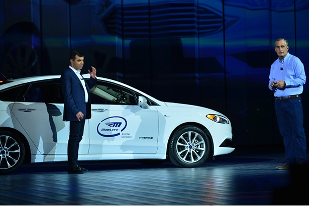 Professor Amnon Shashua (left), senior vice president of Intel and CEO/CTO of Mobileye, arrives on stage in the backseat of an autonomouos car during Intel's preshow keynote at the 2018 Consumer Electronics Show (CES) on Monday, Jan. 8, 2018, in Las Vegas. Shashua joined Brian Krzanich, Intel Corporation chief executive officer, during the keynote. Intel displays how the power of data is affecting our daily lives at the event, which runs Jan. 9-12. <a href=